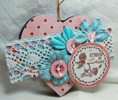 Struck by love heart ornament